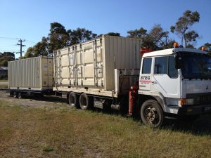 towing multiple sea containers. we also tow trucks, farm equipment, tractors, backhoes, bobcats, excavators, 4WD's, forklifts and smaller vehicles as well as transportable buildings and general cargo cartage.